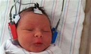 picture of infant receiving hearing screening